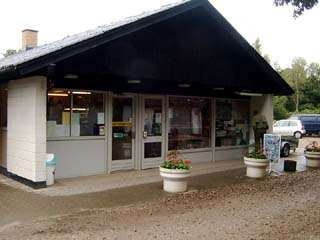 Langå Camping Information Kiosk and grocery. Palm Garden with Grill location